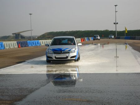 Car on slippery road - Advanced driving training photo
