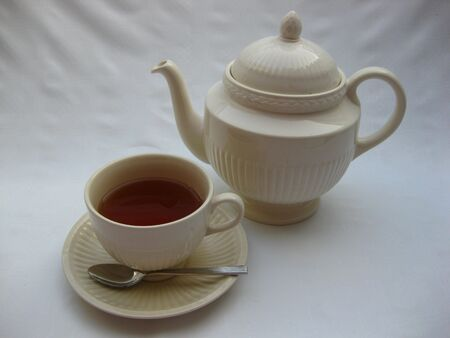 teapot and cup of tea photo