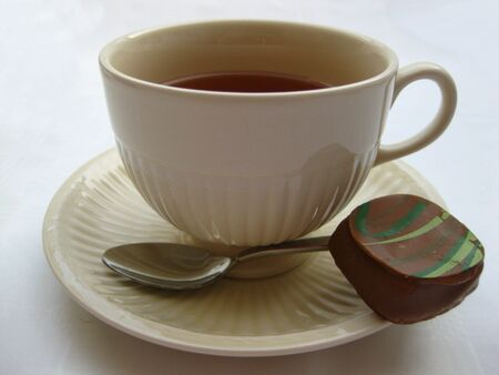 teacup and chocolate photo
