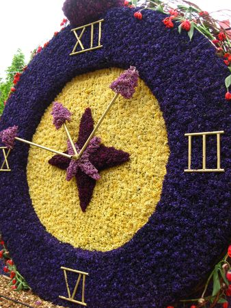flower parade: Clock on flower parade float made of hyacints Stock Photo