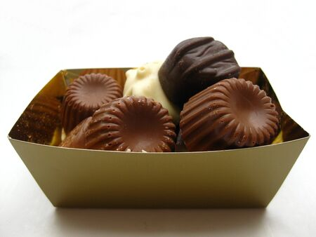 Luxury chocolate pralines in golden box photo