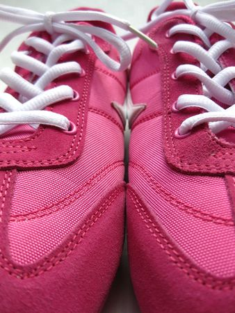 pair of pink sneakers photo
