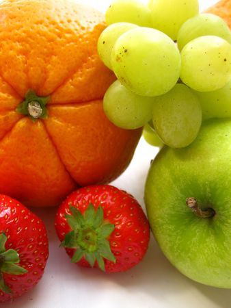 orange, grapes, strawberries and an apple photo