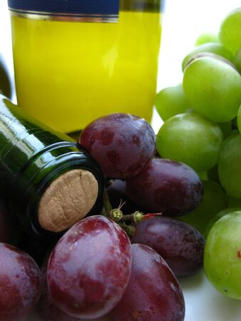 bordeau: wine bottle and grapes