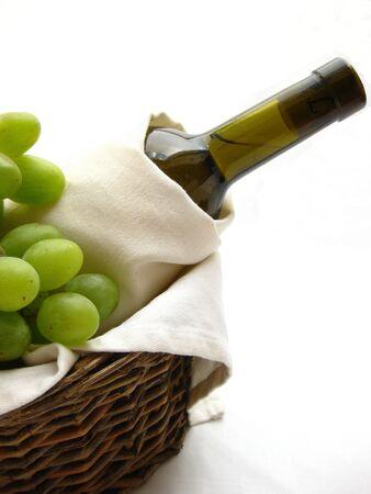 bottle of wine in a basket photo