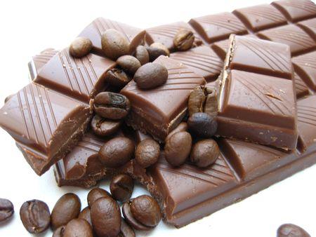 coffee beans over a milk chocolate bar photo
