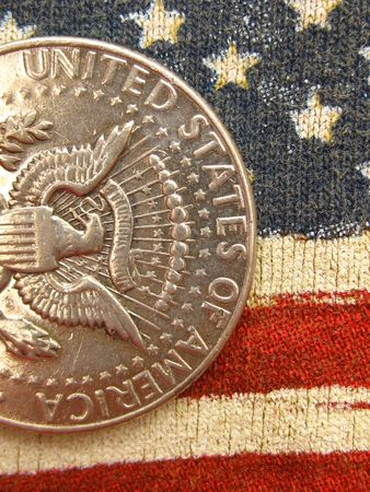 Vintage silver dollar over stars and stripes Stock Photo - 4998410