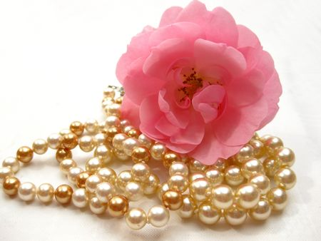pink satin: briar rose and pearls Stock Photo