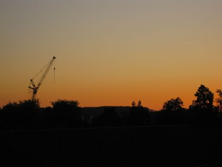 construction crane silhouette in sunset photo