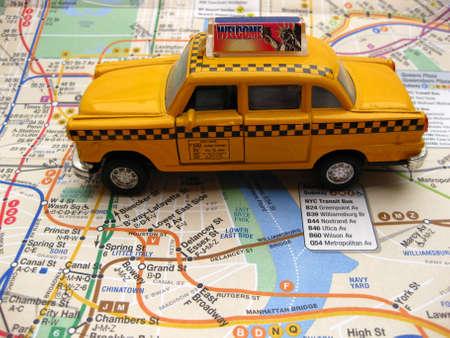 New York transport: yellow cab on subway map photo