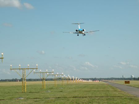Plane approaching runway photo