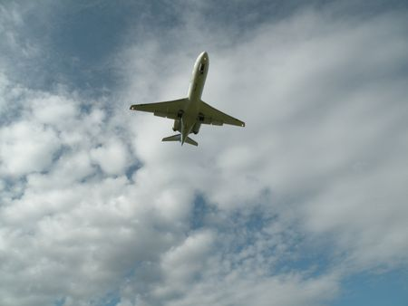 plane in clouded sky photo