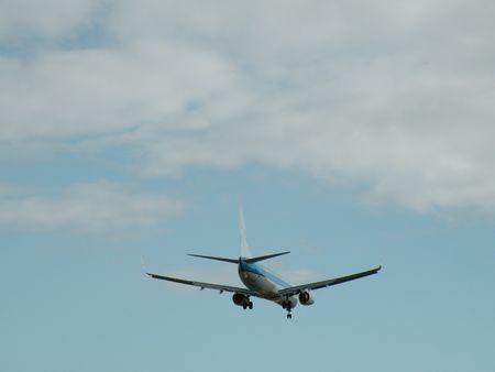 Plane approaching runway photo
