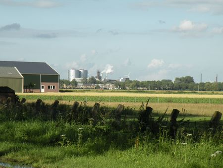dikes: mised landscape: farm and industry Stock Photo