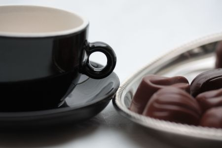 Espresso cup and belgium chocolates photo