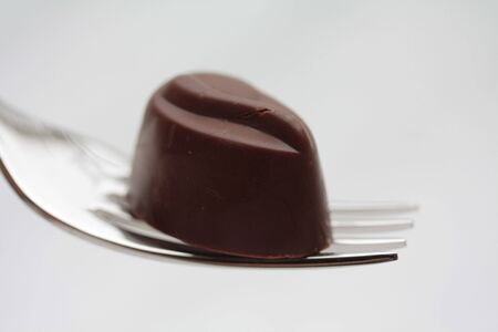 Belgium chocolate praline on fork photo
