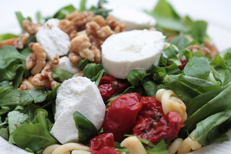 Goat cheese salad with dried tomatoes and walnuts