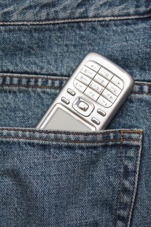 Cellphone in jeans pocket Stock Photo - 5330748