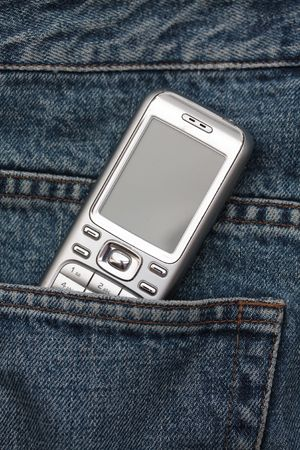 Cellphone in jeans pocket Stock Photo - 5354125