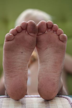 muddy: dirty feet of a playfull six year old