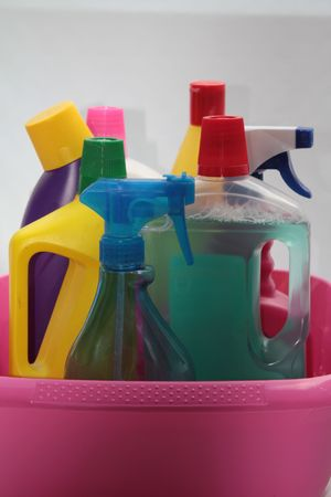 Detergent bottles in bucket photo