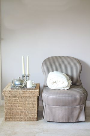 livingroom: Interior design: Classic Biedermeier chair and wicker footstool, serving tray with silver accessoiries