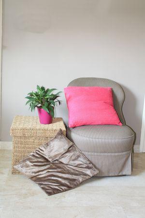 Interior design: Classic Biedermeier chair and wicker footstool Stock Photo - 5386887