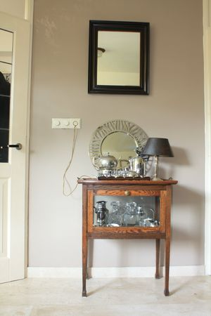Vintage tea cabinet with contemporary decorations photo