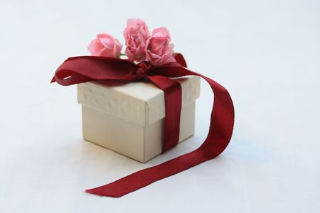 Ring box, decorated with a satin ribbon and pink roses Stock Photo - 5380281