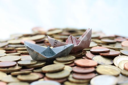 Euro boats sailing on a euro coin sea Stock Photo - 5446855