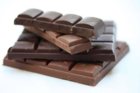 chocolate bar: pieces of a chocolate bar, pure and milk