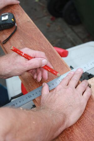A Carpenter Getting Ready For Work, drawing a line on wood Stock Photo - 5568278