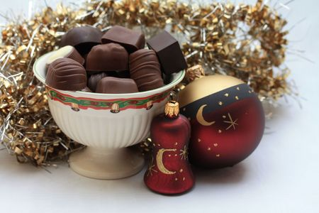 Luxury chocolates and christmas decorations photo