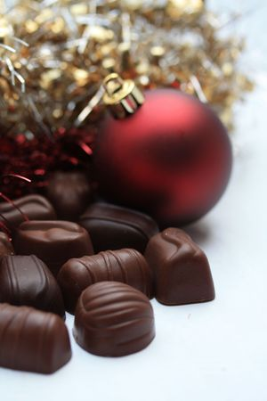Handmade belgium chocolates and christmas ornament photo