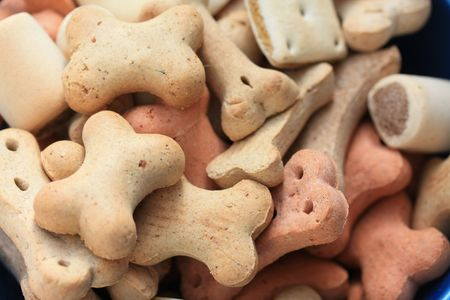 chew over: Crunchy dog cookies or biscuits in different shapes and colors and maybe tastes too... Stock Photo