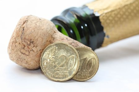 Two euro coins and an open champagne bottle, new years greeting photo