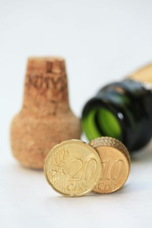 Two euro coins in front of a champagne bottle, perfect new years greeting photo