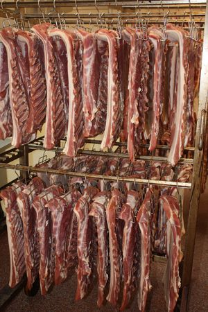 Meat in production proces in a cold cut factory Stock Photo