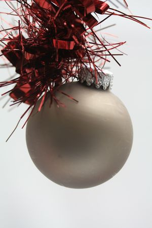 Silver grey christmas ball on a red guirlande Stock Photo - 5692649