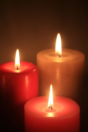 wicca: Three burning candles in a group Stock Photo