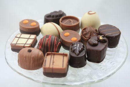 Luxury Belgium Chocolates on a glass presentation plate photo