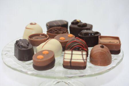 Luxury Belgium Chocolates on glass presentation plate photo