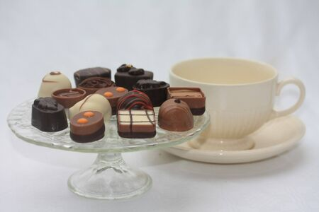 Luxury Belgium chocolates and a tea cup photo