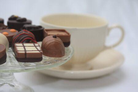 Assorted belgium chocolates and a tea cup photo