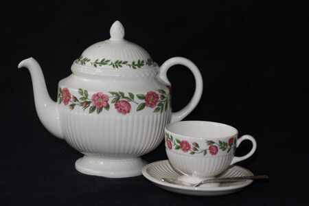 Ivory teapot and teacup with floral design Stock Photo - 5749166