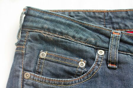 ubiquitous: Detail of a worn pair of blue jeans