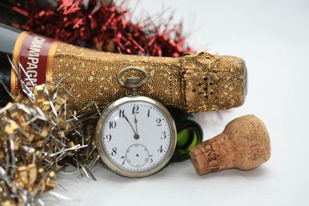 A champagne bottle and a vintage watch, counting down to twelve Stock Photo - 5818152