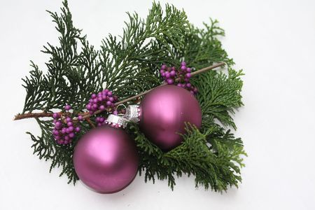 Two purple christmas balls and some purple berries photo