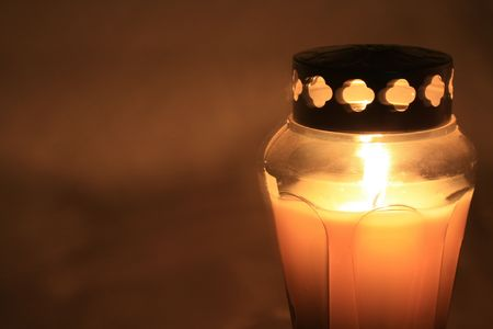 votive candle: Burning votive or grave light with metal cover Stock Photo