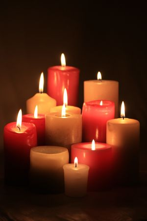 scented candle: A group of burning candles in red and white